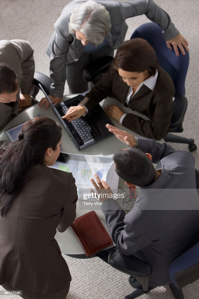 Overhead view of business people having meeting : Foto de stock