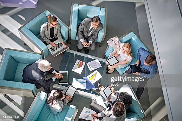 Overhead view of business people  meeting in lobby