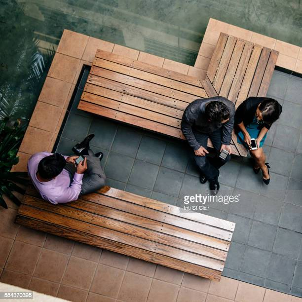 Overhead view of business people sitting in office courtyard