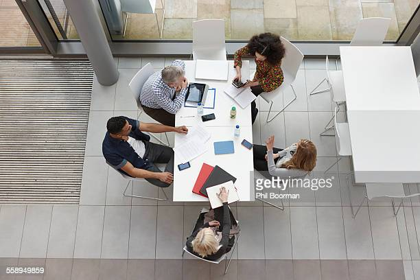 Overhead view of business team having meeting at conference table