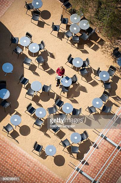 overhead view of cafe tables and businesswoman