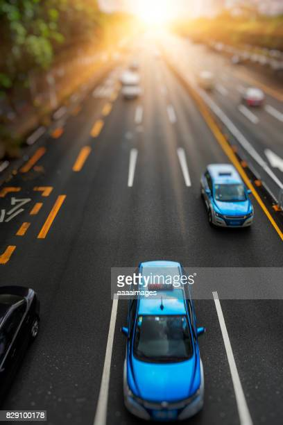 overhead view of cars driving on city road