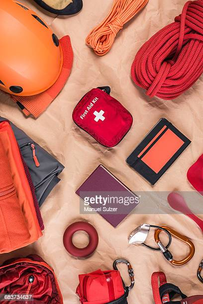 Overhead view of climbing equipment with climbing helmet, first aid kit and climbing ropes