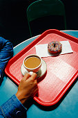 Overhead view of coffee and donut