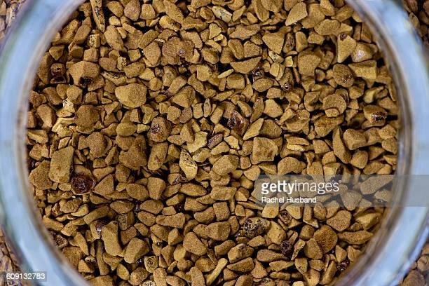 Overhead view of coffee granules in jar