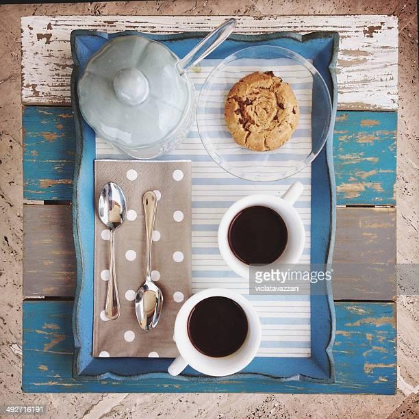 Overhead view of coffee, sugar, cookies