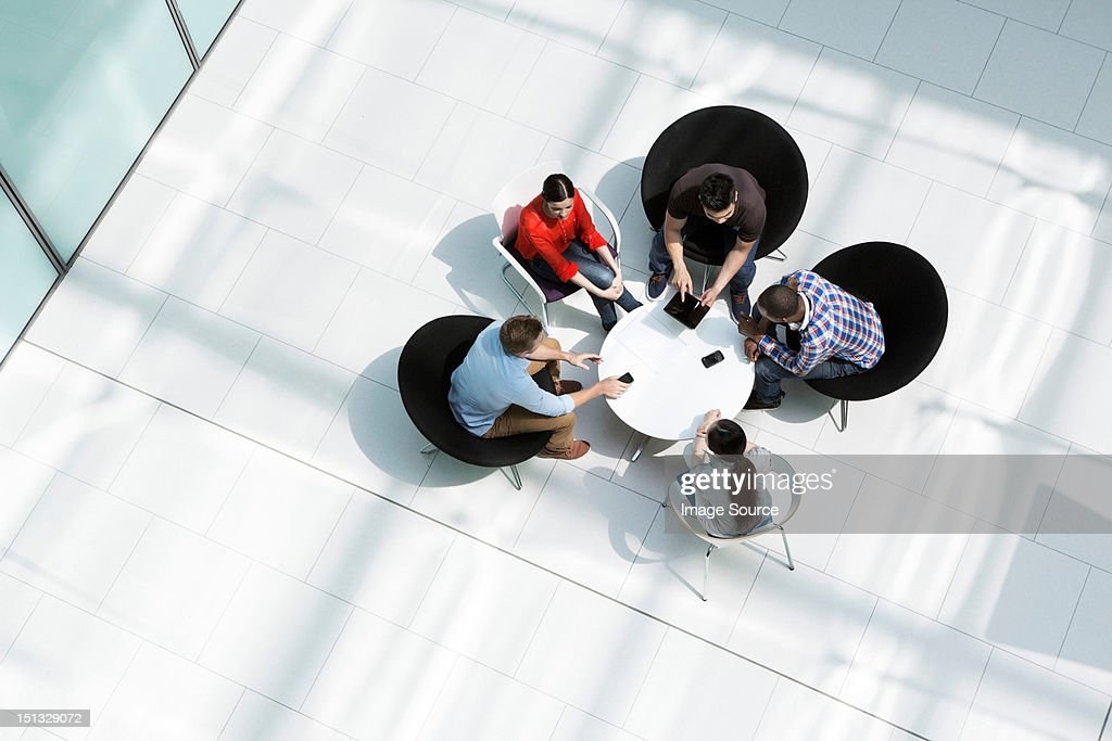 Overhead view of colleagues in meeting