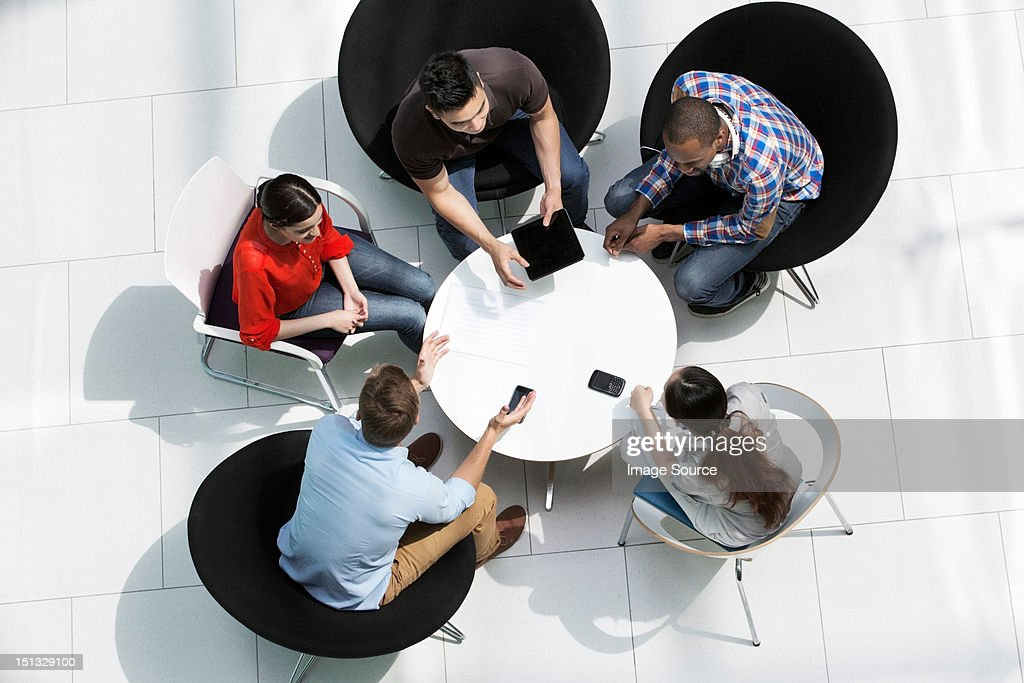 Overhead view of colleagues in meeting : Stock Photo