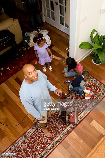 Overhead view of dad cleaning with kids