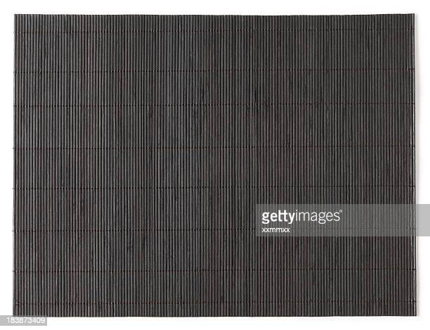 Overhead view of dark stained bamboo mat