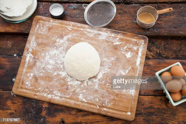 Overhead view of dough on floured cutting board