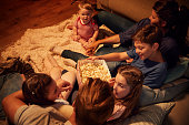 Overhead View Of Family Enjoying Movie Night At Home Together