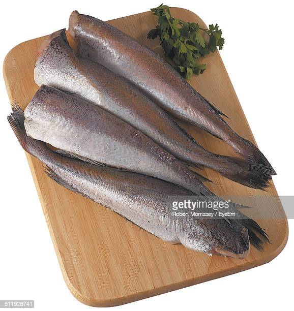 Overhead view of fish on chopping board