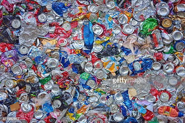 Overhead view of flattened waste aluminium and plastic packaging