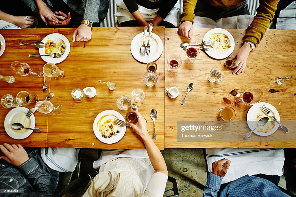 Overhead view of friends at table during party