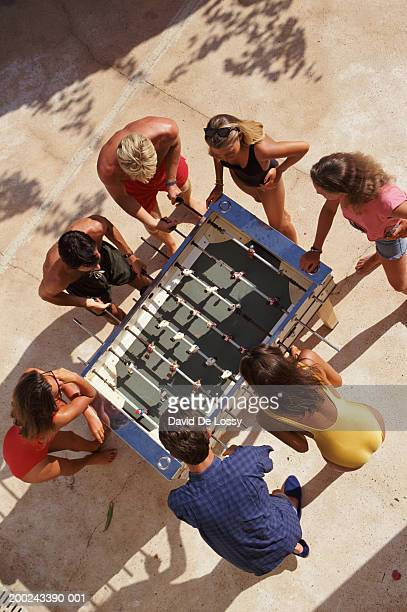 Overhead view of group of people playing table football