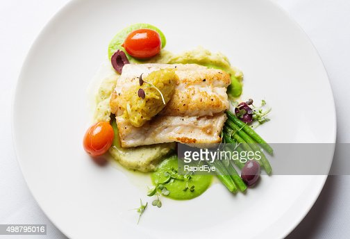 Overhead view of healthy and delicious grilled fish restaurant dish