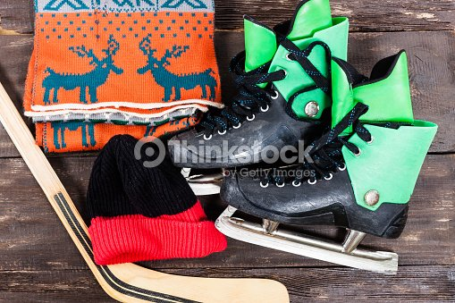 Overhead View Of Hockey Ice Skates Accessories Placed On Old Rustic