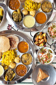 Overhead view of Indian food buffet.