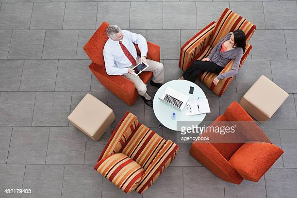 Overhead view of interview in office atrium