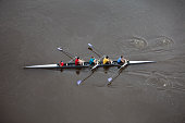 Overhead View of Men Rowing a Four Person Scull.