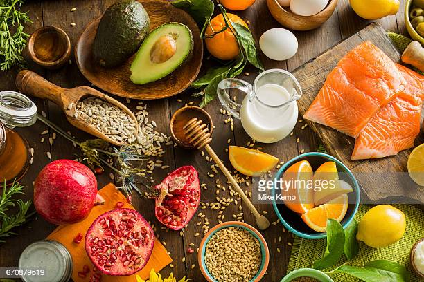 Overhead view of messy table with various fruits and seeds