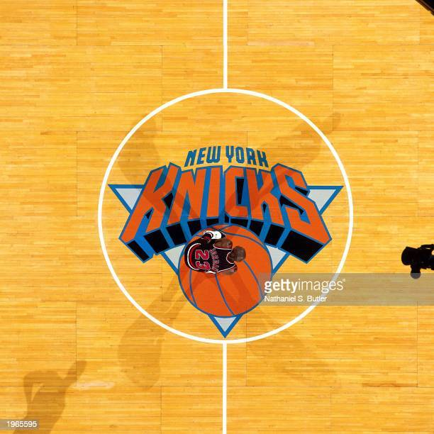 Overhead view of Michael Jordan of the Chicago Bulls as he takes a rest at centercourt against the New York Knicks during the NBA game at Madison...