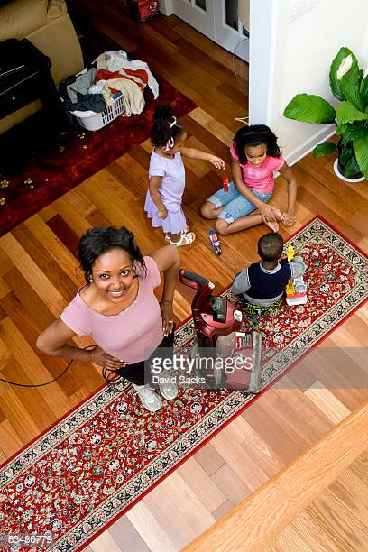 Overhead view of mom cleaning with kids