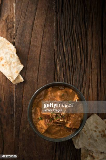 Overhead View Of Paneer Butter Masala And Naan Bread.