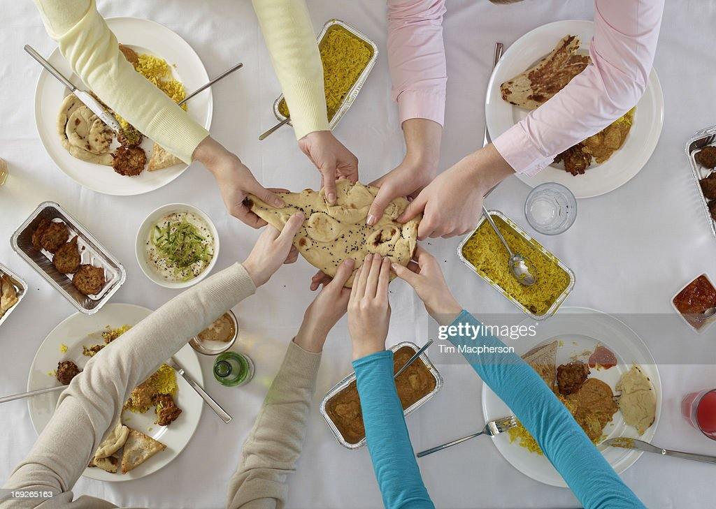 Overhead view of people sharing at table