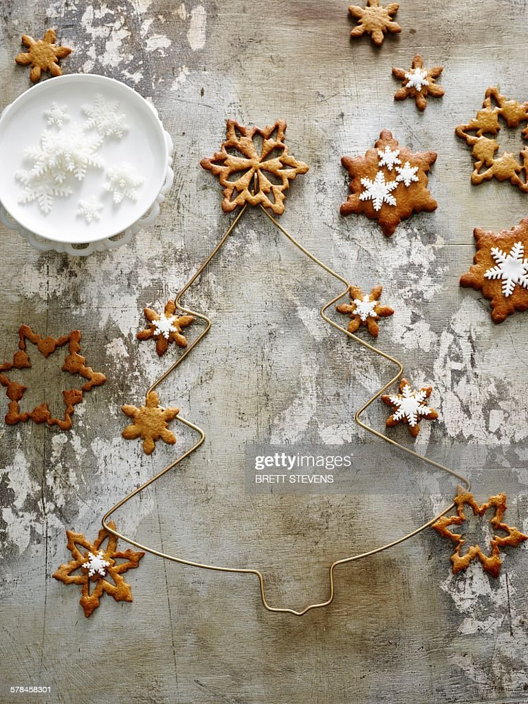 Overhead view of Pernik, star shaped gingerbread cookies with snowflake icing