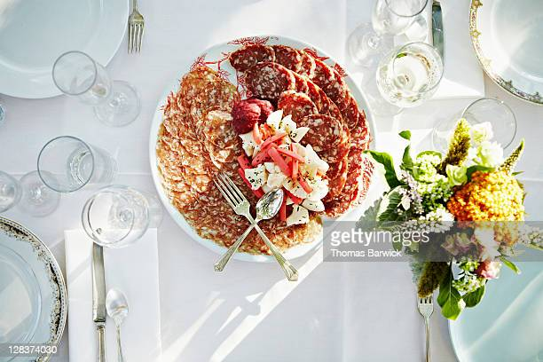 Overhead view of plate salame on outdoor table
