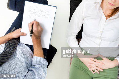 Overhead view of psychiatrist talking to patient : Stock Photo