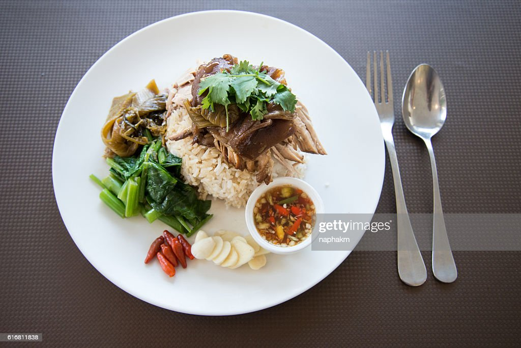 Overhead view of Rice With Roasted Pork Gravy On Plate : Stock Photo