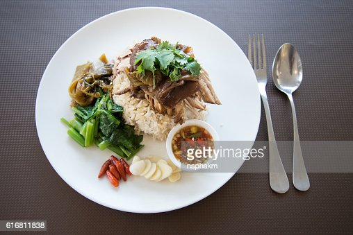 Overhead view of Rice With Roasted Pork Gravy On Plate