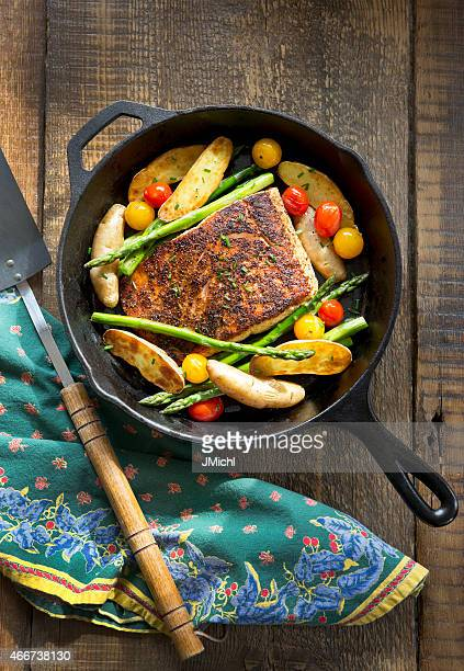 Overhead View of Roast Salmon and Vegetables in Cast-Iron Pan.