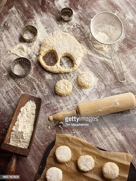 Overhead view of scone dough and pastry cutters