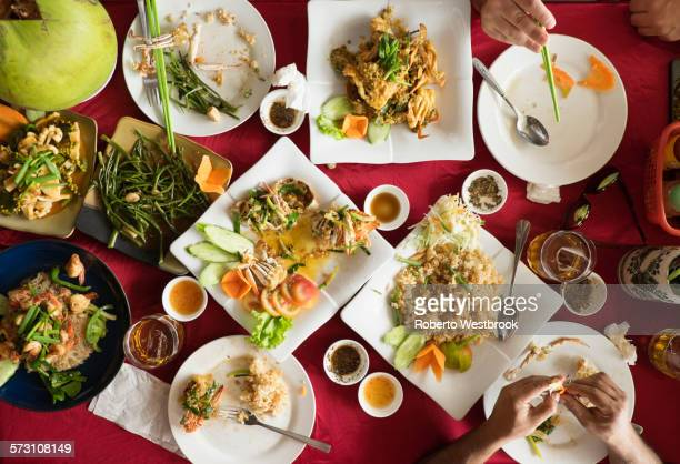 Overhead view of seafood and salad dishes on table