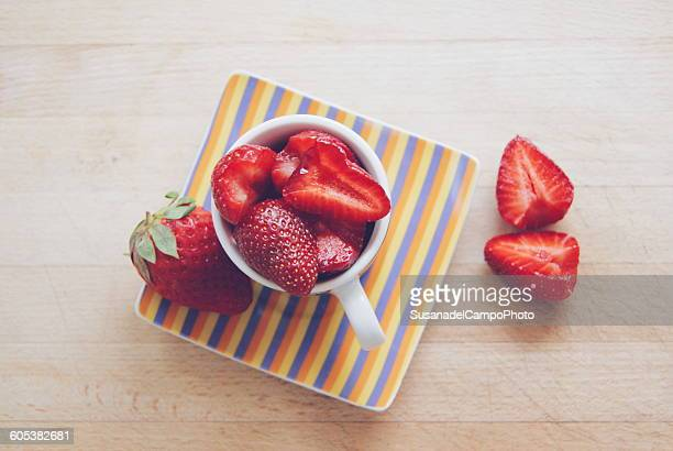 Overhead view of  strawberries in a cup