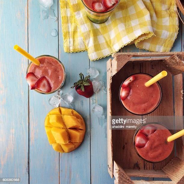 Overhead view of strawberry and mango smoothies