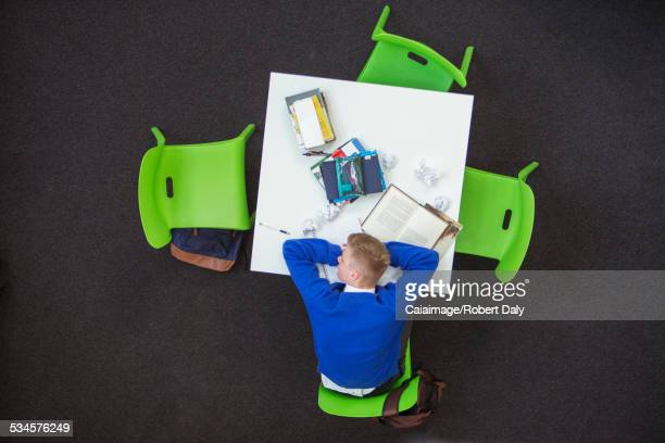 Overhead view of student sleeping on desk
