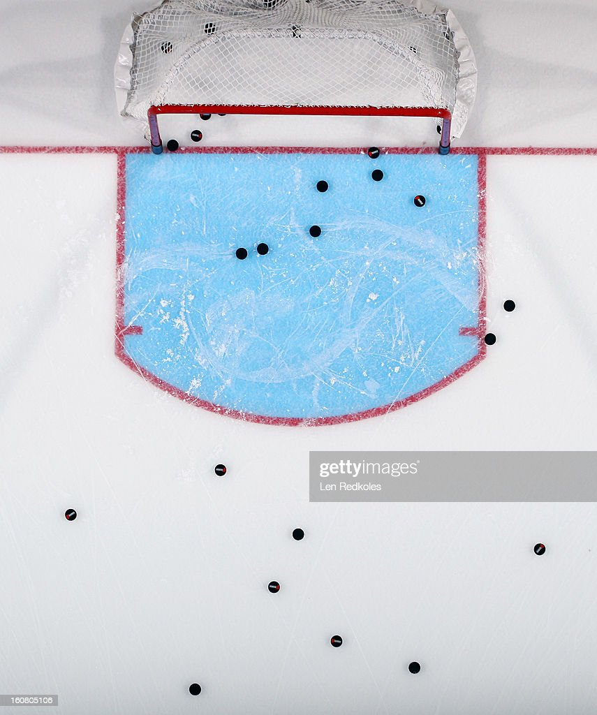 A overhead view of the ice surface and pucks during warm-ups prior to a NHL game between the Philadelphia Flyers and the Carolina Hurricanes on February 2, 2013 at the Wells Fargo Center in Philadelphia, Pennsylvania.