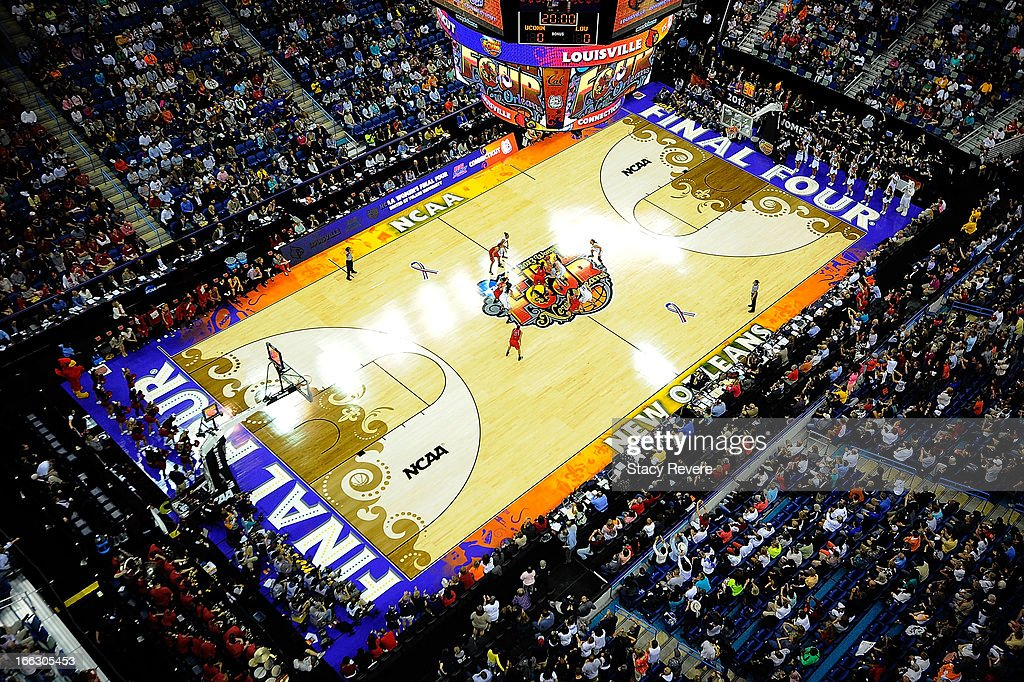 Overhead view of the opening tip between the Connecticut Huskies and the Louisville Cardinals during the National Final game of the 2013 NCAA Division I Women's Basketball Championship at New Orleans Arena on April 9, 2013 in New Orleans, Louisiana.