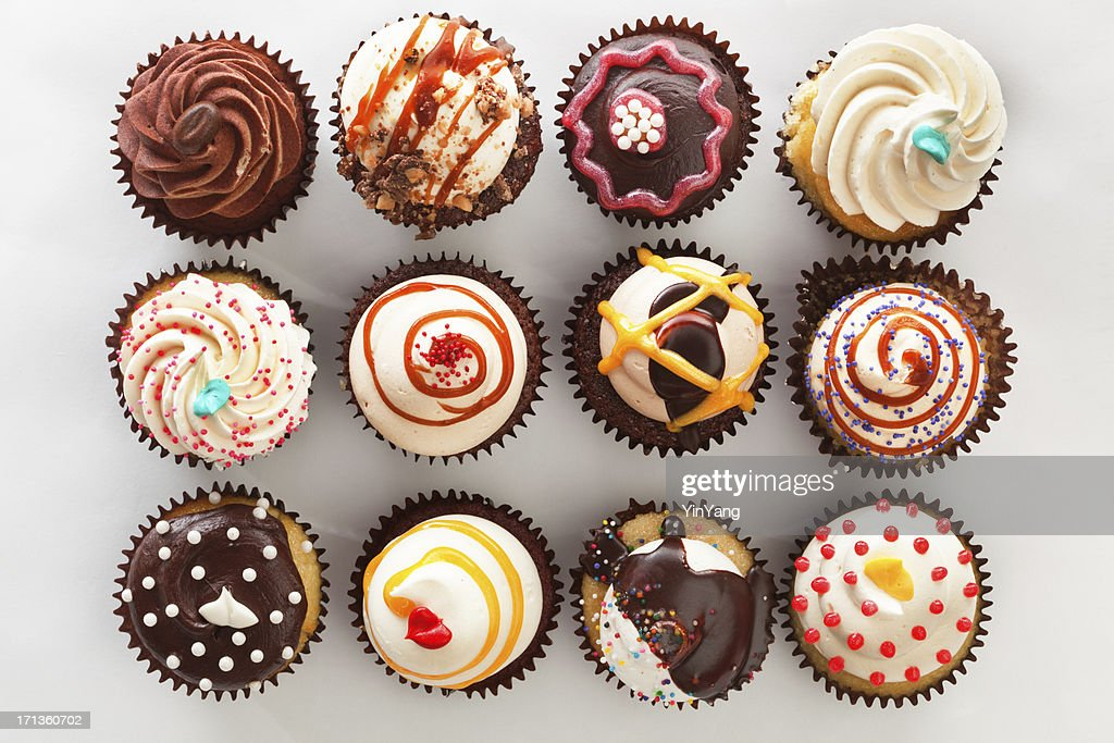 Selection of Gourmet Fancy Cupcake Top View on White Hz