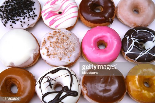 Overhead view of twelve different kinds of donuts