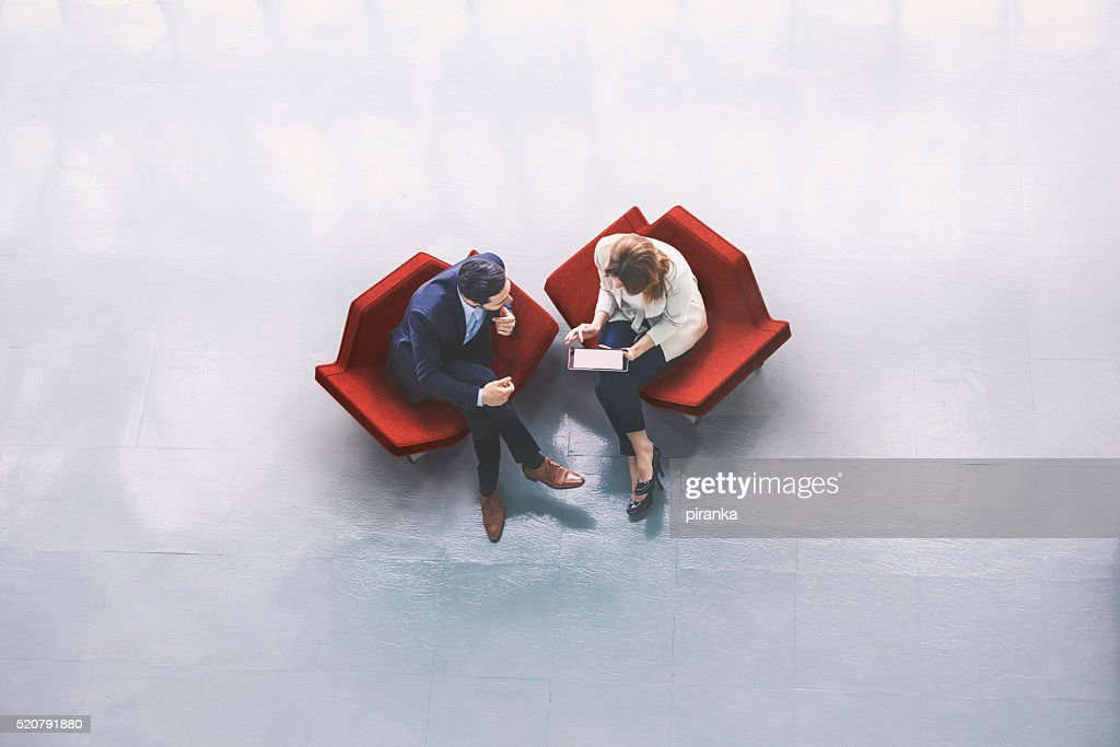Overhead view of two business persons in the lobby : Stock Photo