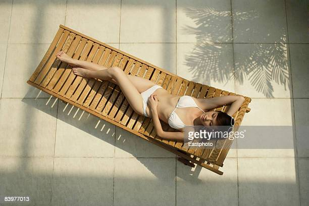 Overhead view of  woman on sun lounger.