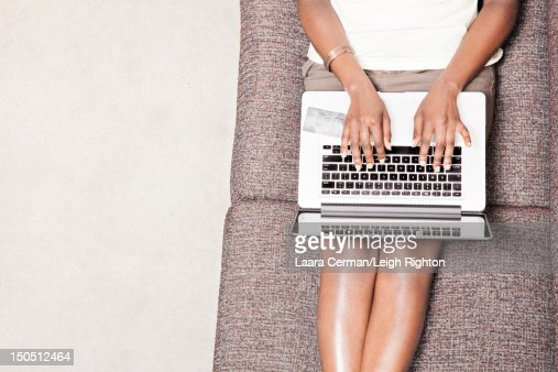 Overhead view of woman online shopping on couch. : Stock Photo