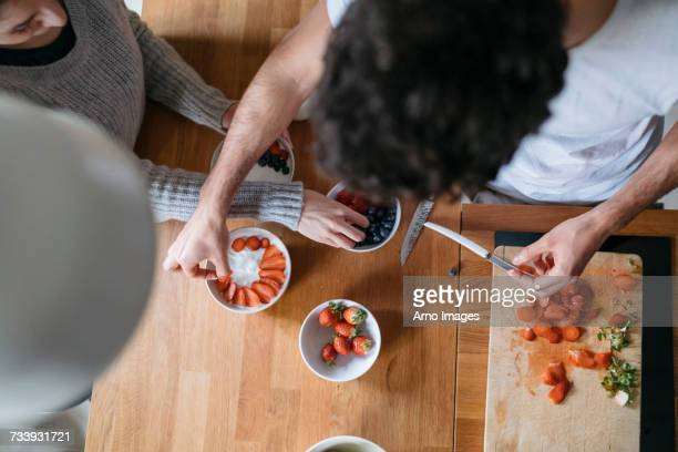 Overhead view of young couple preparing breakfast at kitchen counter