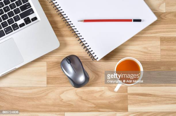 Overhead View Office Stuff On Desk Workplace with Laptop, Mouse, Green Tea, Notepad Retro Style